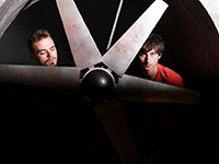 Alexander and Ivan from the IMIRA band near the huge propeller